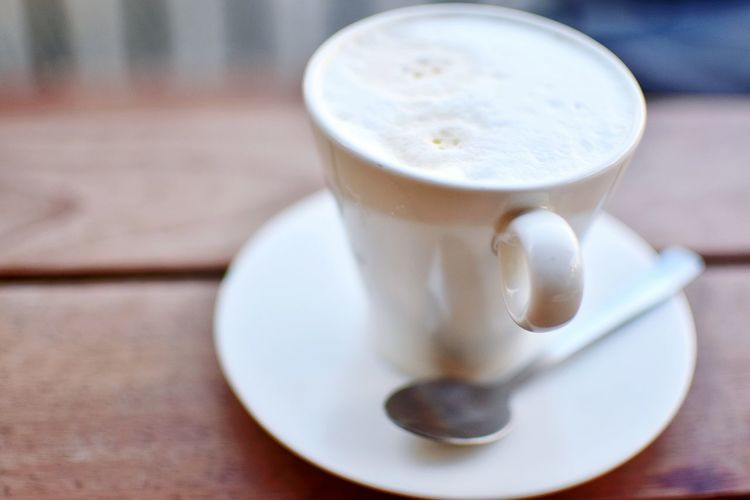 Close-Up Of Latte On Wooden Table