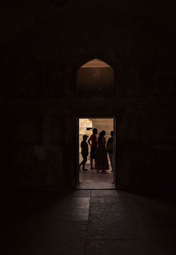 Adult Arcade Arch Architecture Building Built Structure Dark Full Length Group Of People History Indoors  Men People Rear View The Past Tourism Travel Destinations Walking Women