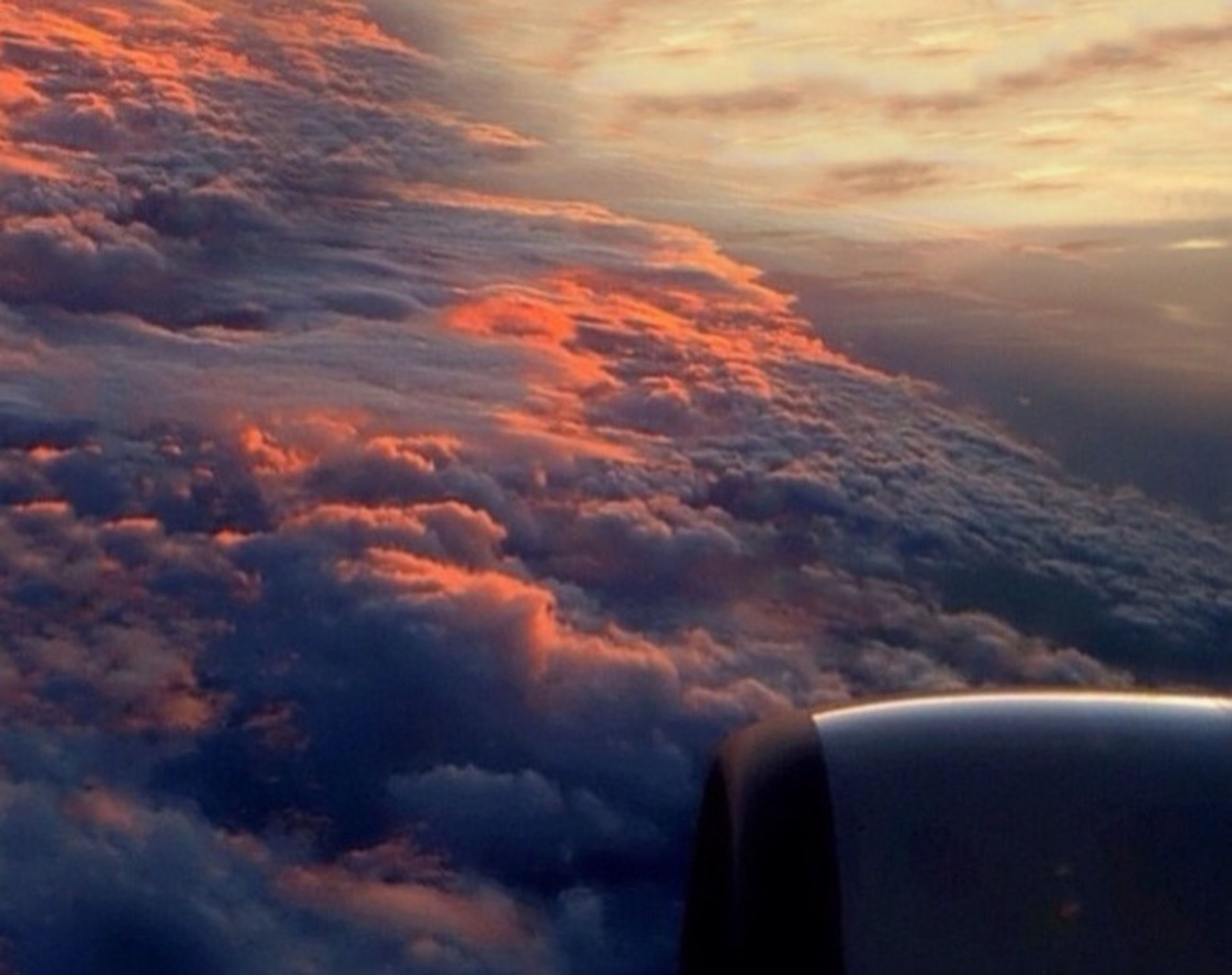 sunset, sky, cloud - sky, cloudscape, cloud, orange color, scenics, beauty in nature, part of, cloudy, dramatic sky, nature, tranquil scene, tranquility, cropped, airplane, idyllic, no people, weather, outdoors