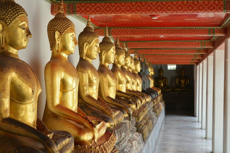 Golden Statues Of Buddha At Temple