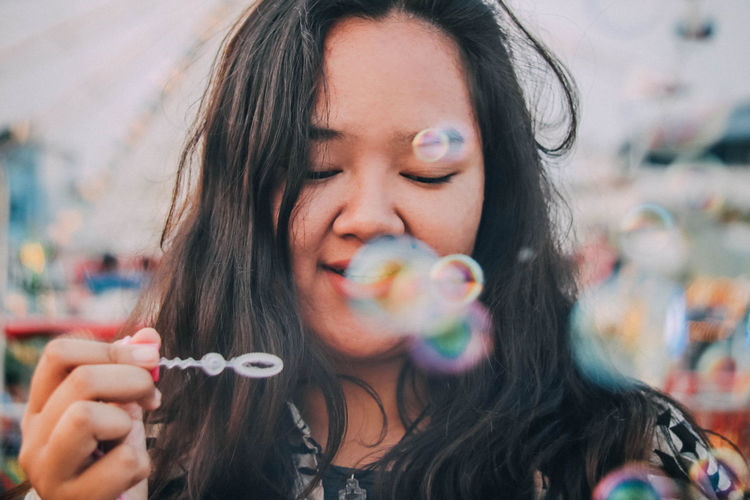 Beautiful just the way you are, darling~ Bubbles EyeEmNewHere Portrait Of A Woman Portraits Relaxing Adult Beautiful Woman Blowing Bubble Enjoyment Hairstyle Happiness Headshot Holding Human Face Lifestyles Long Hair Portrait Portrait Photography Women Young Adult Young Women