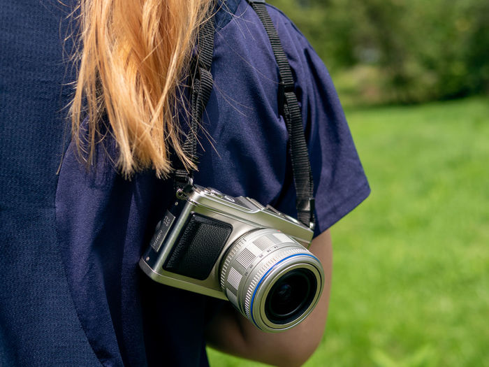 Close-up of woman photographing camera