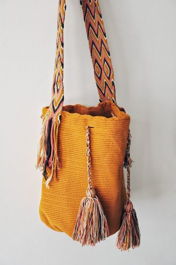 Close-up of bag hanging against wall
