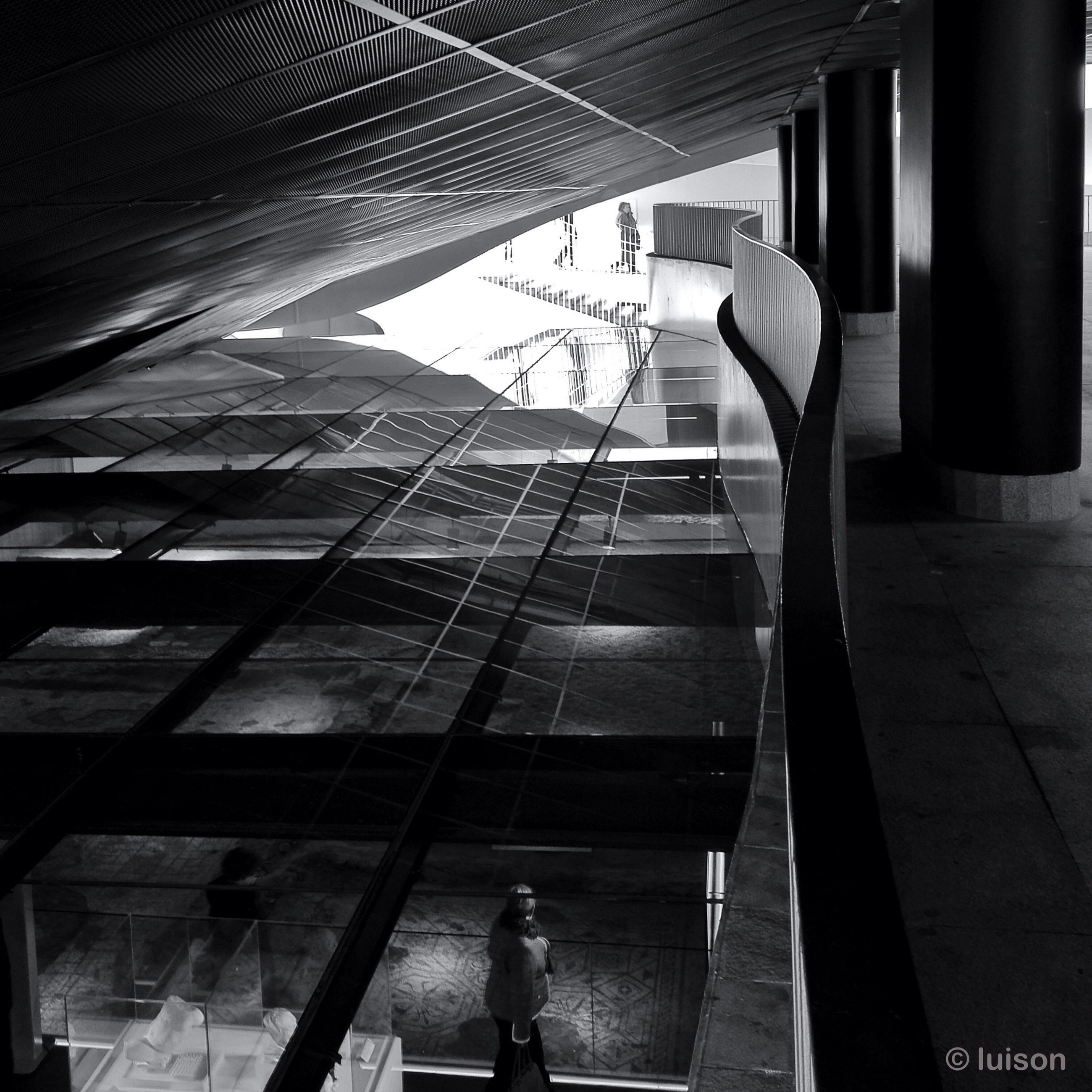 indoors, lifestyles, architecture, built structure, leisure activity, men, person, standing, steps, staircase, steps and staircases, walking, railing, modern, rear view, full length, building, casual clothing