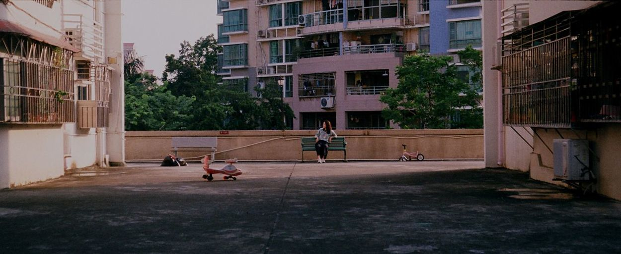 People playing on street against buildings in city