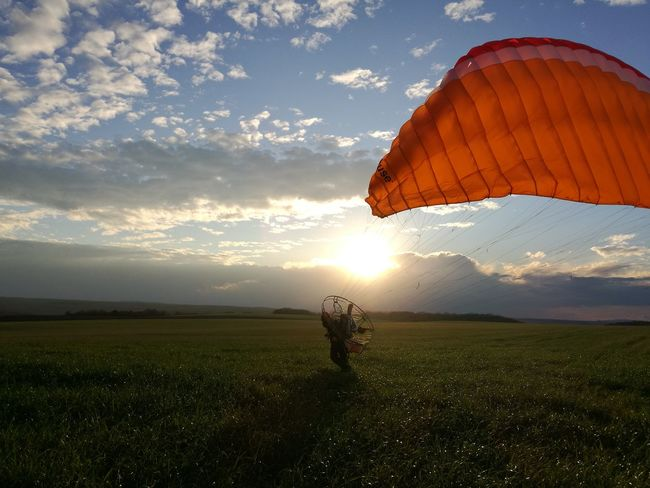 HuaweiP9 Motorparagliding Green Color Field Grass Beauty In Nature Sky Sunlight Sunset Day Outdoors Nature Adult Landscape One Person One Man Only Cloud - Sky No Filter Lifestyles Adventure Men Paragliding Go Higher