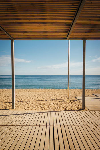 Beach Beauty In Nature Day Deck Horizon Over Water Luxury Nature No People Outdoors Sand Scenics Sea Sky Summer Sunlight Tranquil Scene Tranquility Tropical Climate Vacations Water Wood - Material Wood Paneling