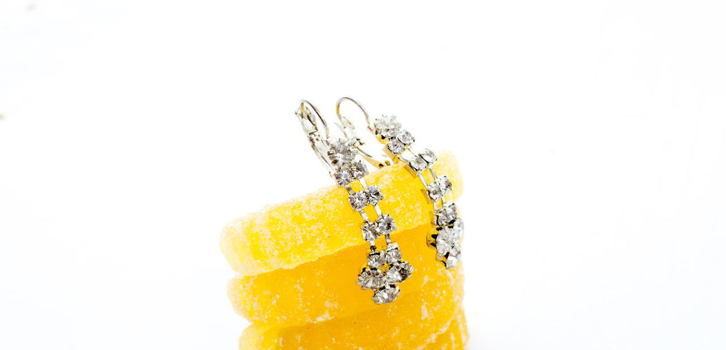 silver earrings on jelly bonbon Love Citrus Fruit Close-up Food Food And Drink Freshness Fruit Gift Healthy Eating Indoors  Jelly Bonbon Jelly Candy Jewelry Lemon Orange Orange Color Precious Gem Silver Earrings Studio Shot Temptation Wellbeing White Background Yellow