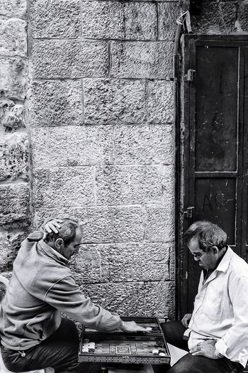 backgammon players in Jerusalem's Old City. Blackandwhite Muslim Palestine Israel Jerusalem Men Playing Games Low Section Sitting Close-up Personal Perspective