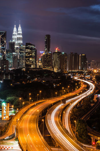 The City Skyline in Kuala Lumpur KLCC Twin Towers Kuala Lumpur Architecture Building Exterior Built Structure City City Life Cityscape High Angle View High Street Highway Light Trail Long Exposure Malaysia Motion Night No People Outdoors Road Sky Skyscraper Street Light Transportation Travel Destinations Urban Skyline