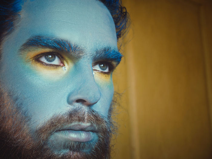 Actor Makeup Man Adult Beard Blue Body Part Close-up Contemplation Eye Faceart Greasepaint Headshot Human Face Looking Looking Away One Person Portrait Real People