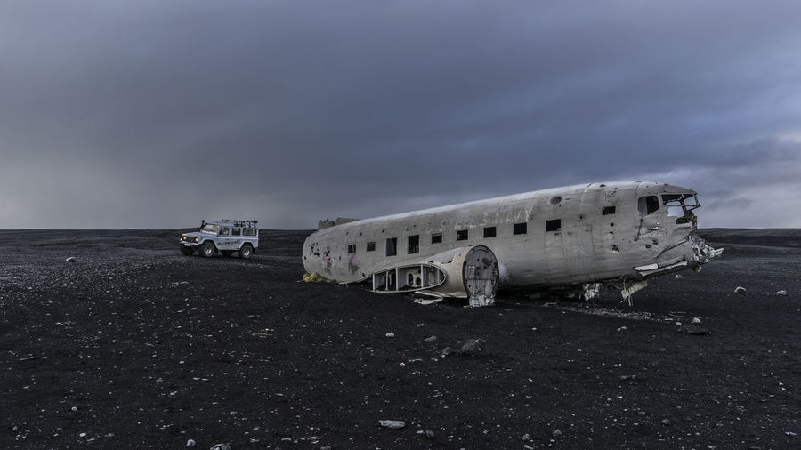 Off-Road Vehicle Parked By Crashed Dc-3 Airplane At Black Sand Beach