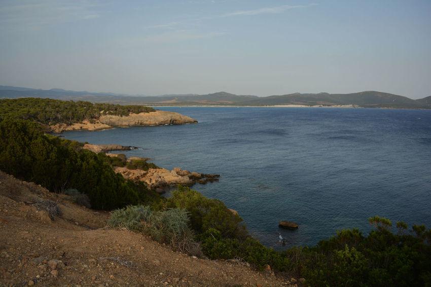The Great Outdoors - 2018 EyeEm Awards Santadi Sardegna Sardegnaofficial Water Sea Beach Sunset Mountain Sunlight Sky Landscape Horizon Over Water Architecture Rocky Coastline Stack Rock Coast Island