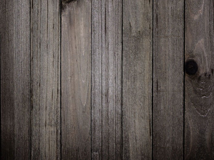 These vertical wood panels each have a different look to the wood grain. Panel Straight Backdrop Backgrounds Brown Copy Space Full Frame Knotted Wood No People Plank Rough Rustic Simple Background Texture Textured  Vertical Weathered Weathered Wood Wood - Material Wood Grain Wood Paneling