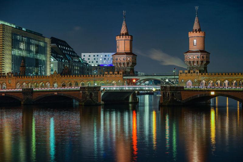 Illuminated Bridge Over River At Night