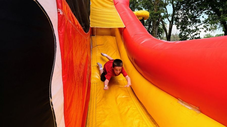 Boy Sliding On Slide