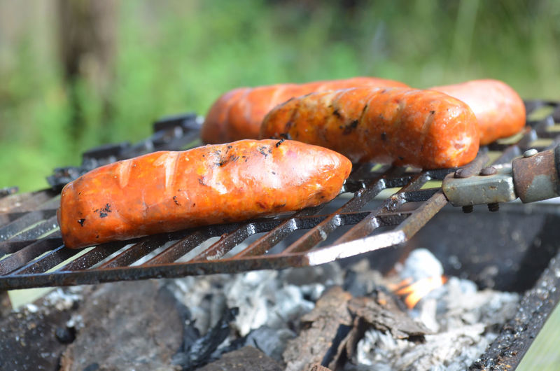 Close-Up Of Sausages Being Grilled On Barbecue