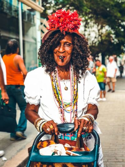 Cubana Real People Incidental People Focus On Foreground Lifestyles Market Food Day Women Front View People City Street Outdoors Hairstyle Architecture Adult