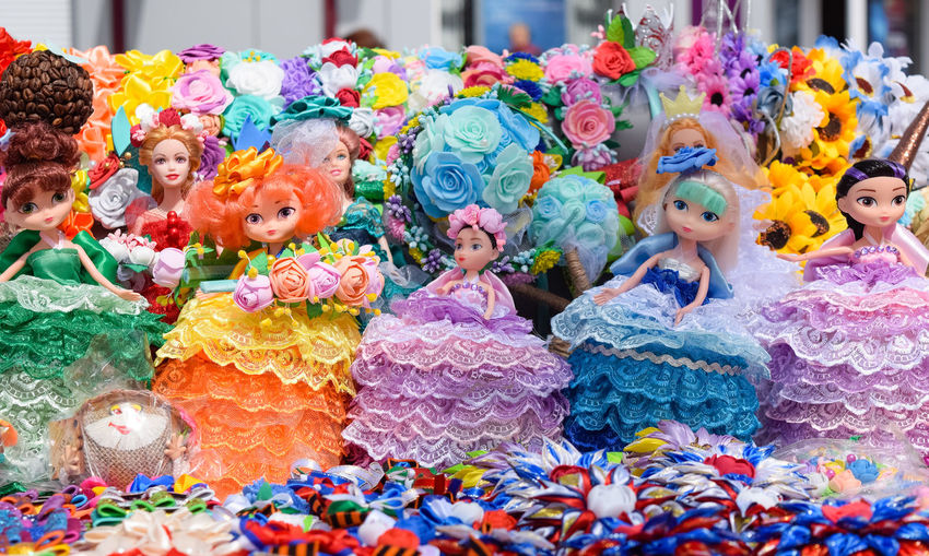 Close-up of multi colored toys for sale at market