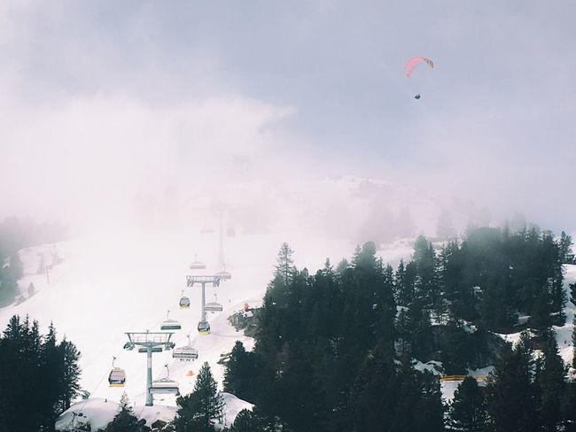 Architecture Cloud - Sky Day Escape Flying Fog Holiday Mountain Mountain Range Nature No People Outdoors Parasailing Ski Sky Snow Sport Tree Winter Holidays