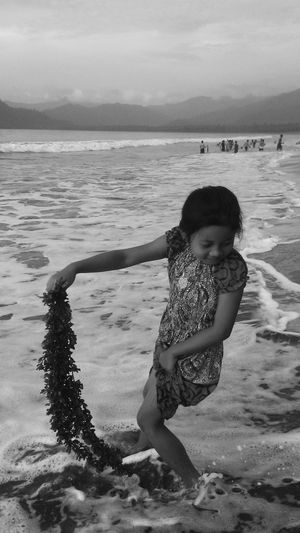 cheerfulness on the beach Blackandwhite Beach Sand Sea One Person Children Only One Girl Only Water Day Girls Outdoors Child Beauty In Nature Playing EyeEmNewHere Press For Progress Go Higher Inner Power End Plastic Pollution This Is Family Summer Exploratorium The Great Outdoors - 2018 EyeEm Awards The Still Life Photographer - 2018 EyeEm Awards The Traveler - 2018 EyeEm Awards The Fashion Photographer - 2018 EyeEm Awards The Troublemakers The Photojournalist - 2018 EyeEm Awards My Best Photo Analogue Sound
