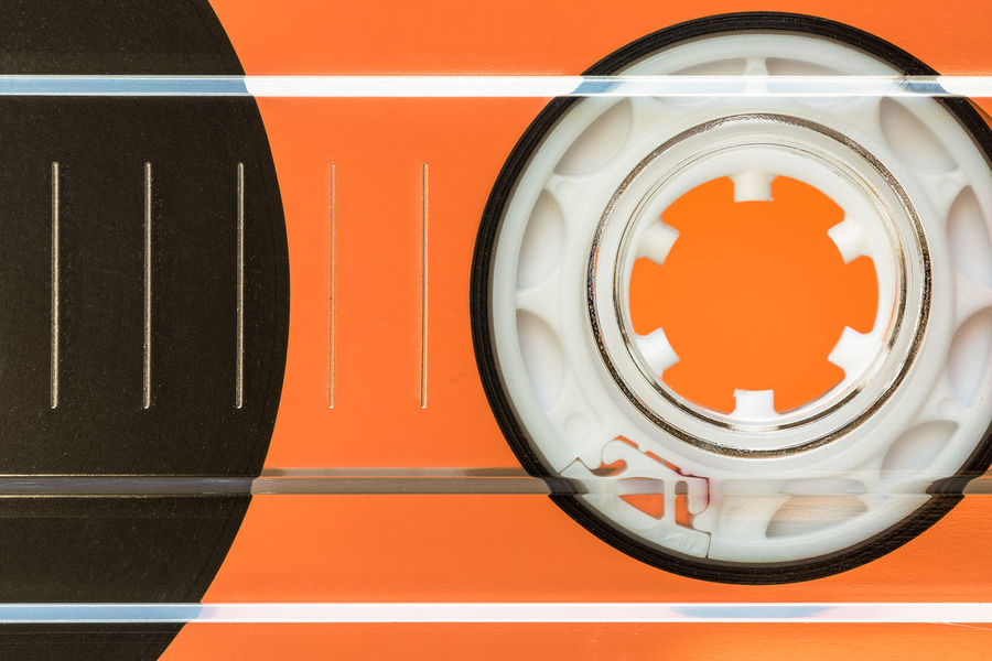 macro of cassette tape Cassette Tape Music Magnetic Tape EyeEm Selects Orange Color Full Frame Close-up Geometric Shape Orange Background Circle