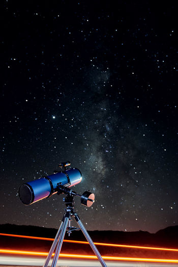 Low angle view of camera against sky at night