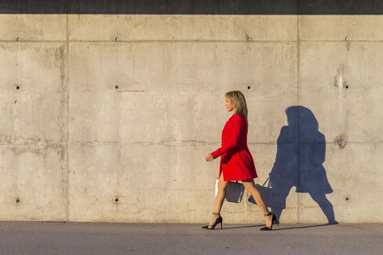 Fashionable woman walking in city