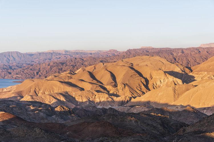 Arid desert mountains against the backdrop of the red sea. shlomo mountain, eilat israel