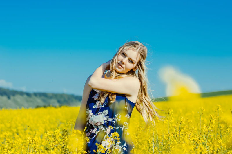Yellow Flower Land Flowering Plant One Person Blond Hair Hair Field Nature Plant Long Hair Blue Beauty In Nature Sky Young Adult Growth Women Leisure Activity Young Women Hairstyle Beautiful Woman