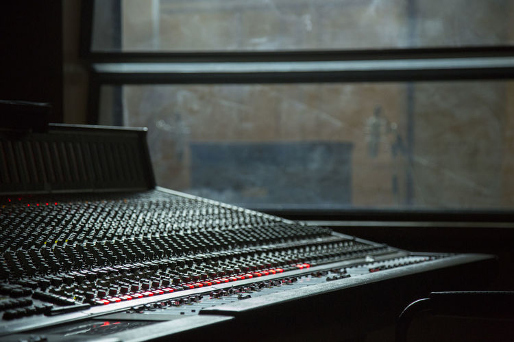 Close-up of sound mixer in recording studio
