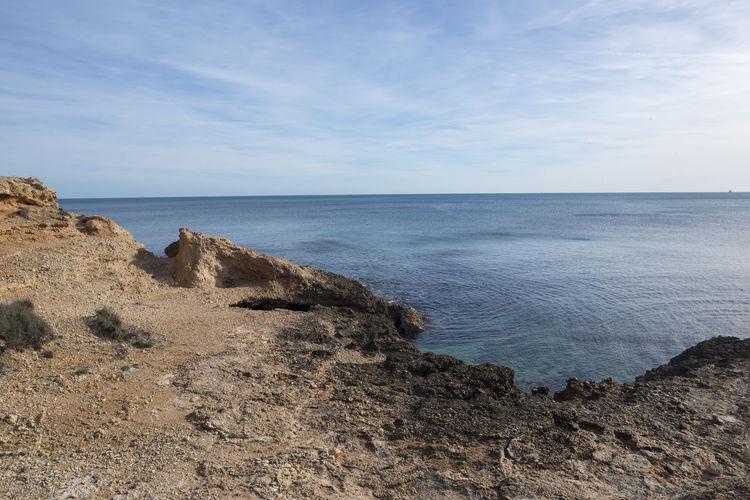 Tarragona Costa Daurada Sea Sky Horizon Scenics - Nature Horizon Over Water Tranquil Scene Beauty In Nature Water Tranquility Beach Land Nature No People Rock Non-urban Scene Day Idyllic Rock - Object Cloud - Sky Outdoors Rocky Coastline