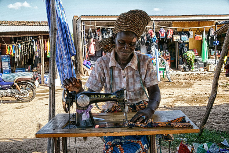 One Person Working Real People Occupation Men Day Adult Bicycle Art And Craft Incidental People Sitting Business Front View Craft Work Tool Transportation Lifestyles Skill