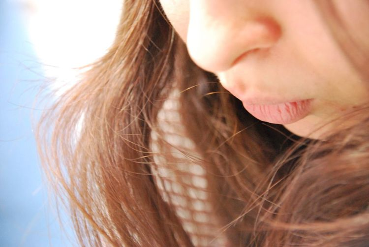Close-up of woman with brown hair