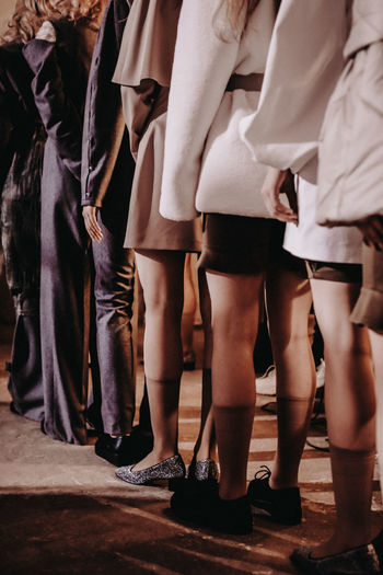 Models getting in a line on backstage during fashion week