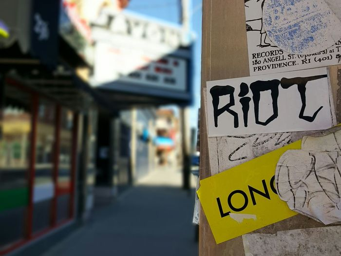 Quiet Riot. Focus On Foreground No People Close-up Day Theatre Marquee Text Light Outdoors Communication Sidewalk Views Light And Shadow City EyeEm Best Shots Rhode Island Photography⚓