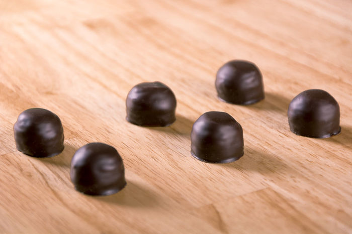 Set of dark chocolate bonbon on wood table Bright Confection Dark Dark Chocolate Dessert Desserts Eating Food And Drink Home Sugar Textured  Valentine's Day  Wood Backgrounds Bonbon Brown Candy Choccolate Close-up Food Praline Sweet Table Unhealthy Wood - Material