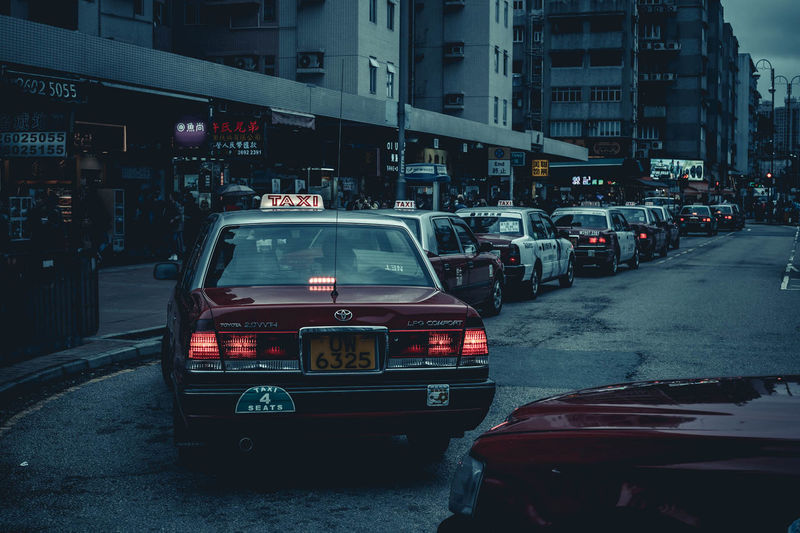 Taxi Taxi Driver Architecture Building Building Exterior Built Structure Car Carred City City Life City Street Dusk Illuminated Incidental People Land Vehicle Mode Of Transportation Motor Vehicle Night Road Street Traffic Transportation Travel