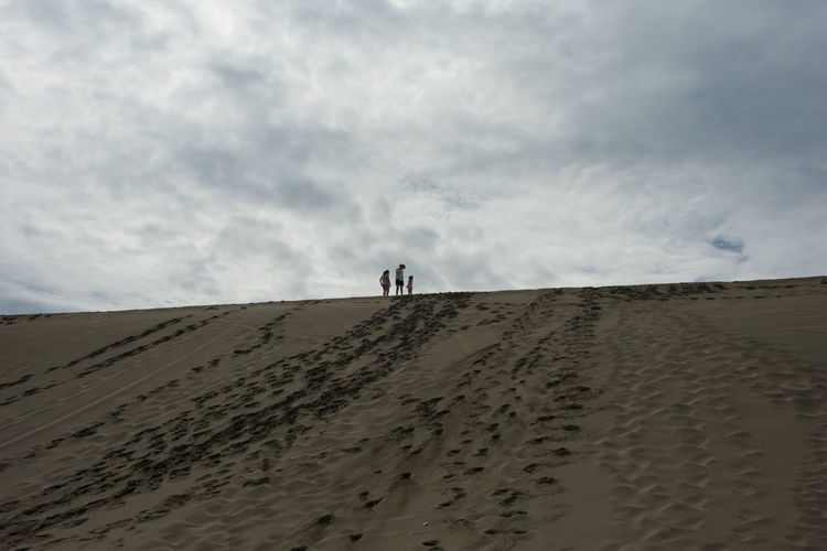 Sand Sand Dune Beach Desert Outdoors Walking Real People Vacations People FootPrint Beauty In Nature Full Length Nature Lifestyles