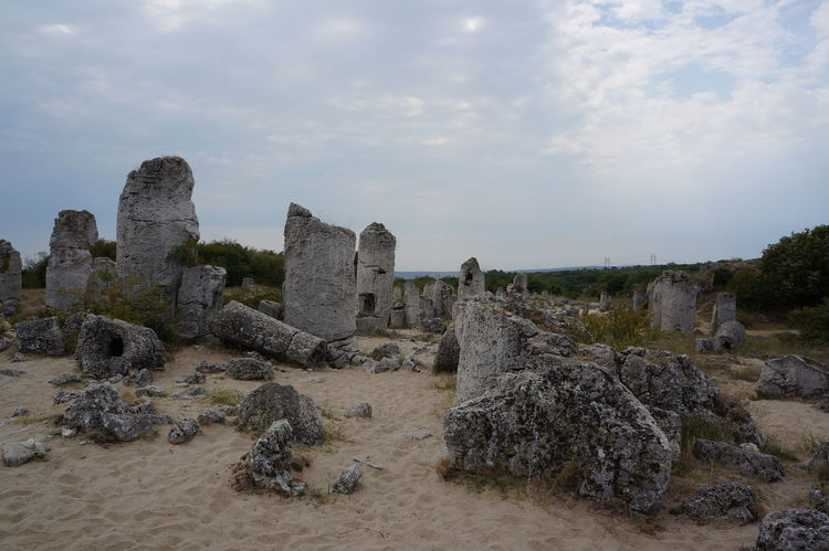 Pobiti kamani , The stone desert Beach Beauty In Nature Cloud Cloud - Sky Cloudy Day Landscape Nature Old Ruin Outdoors Pobiti Kamani Pobiti Kamuni Rock - Object Rock Formation Sand Scenics Sky Stone Stone - Object Stone Desert Sunlight Tourism Tranquil Scene Tranquility Traveling
