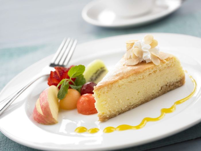 Close-Up Of Cake And Fruits On Plate