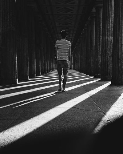 Blackandwhite Photography Blackandwhite Berlin Berlin Photography Full Length Rear View Real People One Person Sunlight Shadow Walking Direction The Way Forward Lifestyles Men Day Architecture Standing Leisure Activity Transportation Diminishing Perspective Outdoors