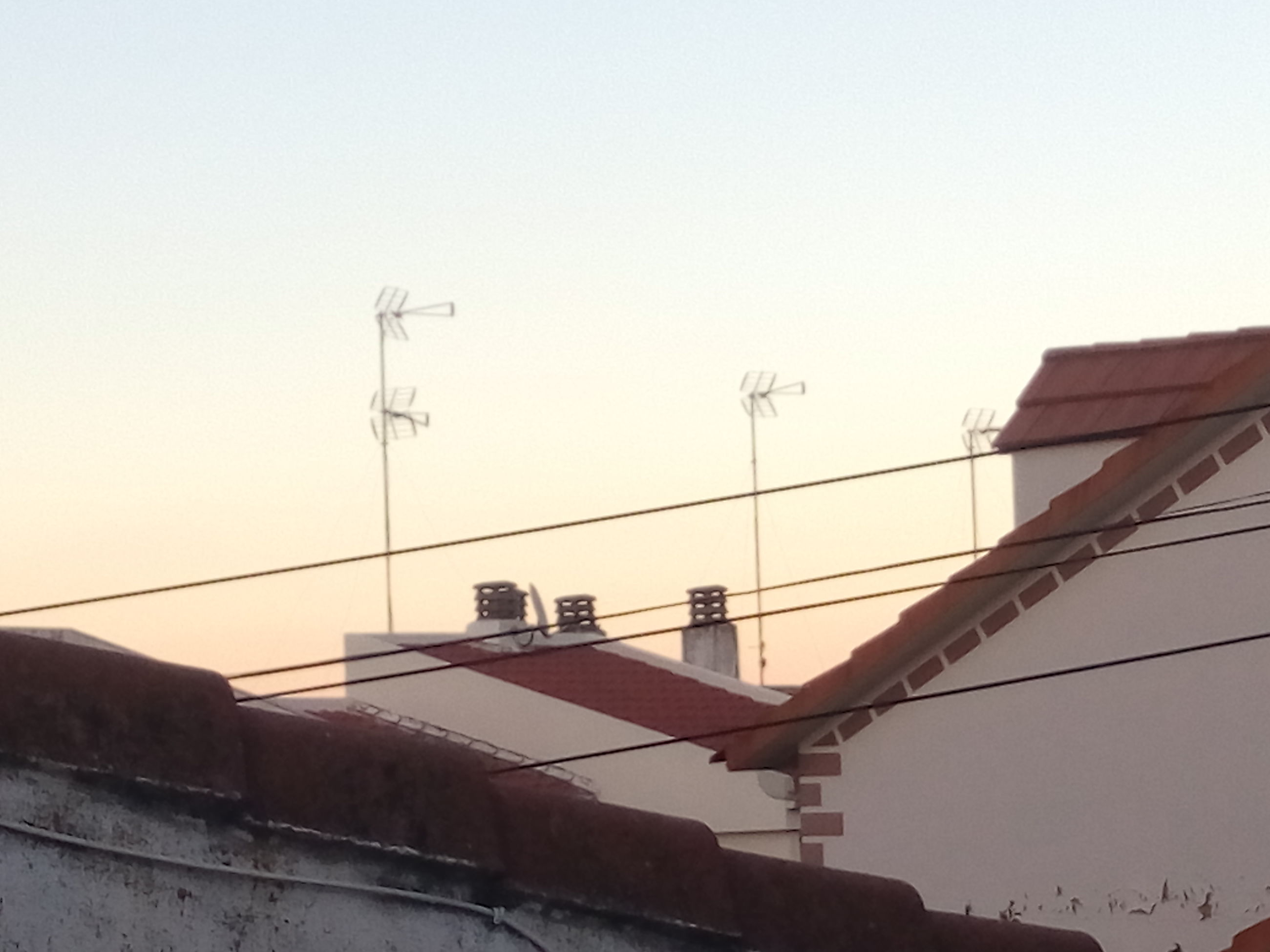 building exterior, connection, built structure, architecture, roof, clear sky, television aerial, no people, antenna - aerial, low angle view, telecommunications equipment, technology, outdoors, day, antenna, satellite dish, sunset, tiled roof, sky