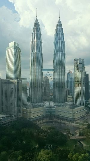KLCC City Skyscraper Architecture Cityscape Modern Building Exterior Travel Destinations Urban Skyline Travel Business Finance Built Structure Business Finance And Industry Cloud - Sky Futuristic Outdoors Growth Downtown District No People Sky