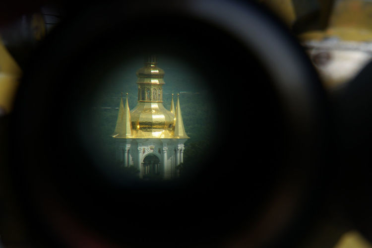 looking through some magnifying glass Travel Vacation Illuminated Architecture Hanging Connection Focus On Foreground Electric Light Building Technology Church Catholic Copy Space Gold Colored Part Of Lavra No People Day Electric Lamp Lighting Equipment