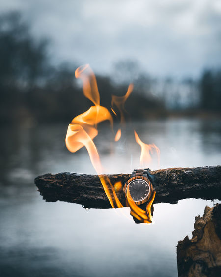 Lost time is never found again Burning Rain Bonfire Burning Clock Close-up Cloud - Sky Communication Day Fire Fire - Natural Phenomenon Flame Focus On Foreground Heat - Temperature Log Motion Nature No People Orange Color Outdoors Product Photography Sky Time Watch Wood - Material