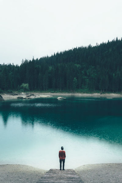 Thinking man standing at a mountain lake Flims Switzerland Caumasee Schweiz Suisse  Svizzera Mountain Lake Lake Lake View Thinking Man Thoughts Thinking About Life Standing At Lake Tones Film Photography Vscofilm Cauma Graubünden Hidden Gems