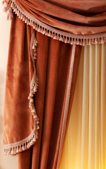 Close-up of curtain against wall at home