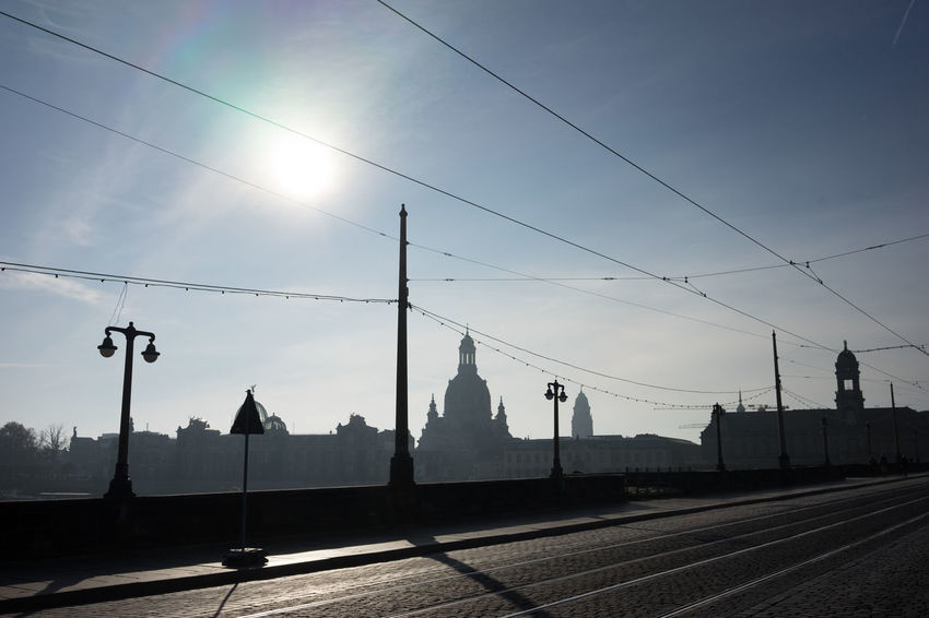 Sunny Sunday morning stroll through Dresden Architecture Augustusbridge Augustusbrücke Back Lit Cable City Cloud - Sky Day Dramatic Sky Dresden Neustadt Electricity Pylon No People Outdoors Power Line  Sky Streetphoto_color Sunset Transportation Travel Destinations