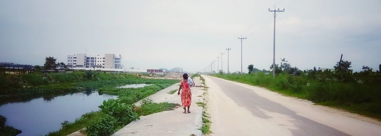 proverty is her road-mate. Footpath Photography Streetphotography Urban Single Water Working Rural Scene Headwear Electricity Pylon